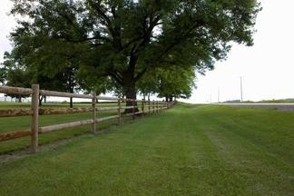 Wood fence surrounding a huge ranch in Baton Rouge. Fence sits a few yards from highway.
