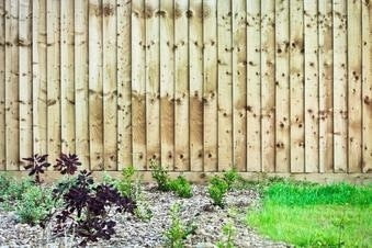 This picture shows a wood fence that was built around a garden. This was taken in Baton Rouge prior to staining.